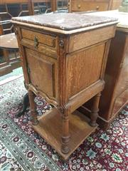 Sale 8917 - Lot 1021 - Early 20th Century French Oak Bedside Cabinet, with brown marble top, a drawer, door and turned legs joined by a shelf