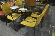 Sale 8368 - Lot 1024 - Five Piece Metal Outdoor Setting incl. Glass Top Table & Four Wicker Chairs
