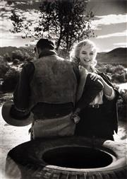 Sale 8773A - Lot 5045 - Eve Arnold (1912 - 2012) - Marilyn Monroe with Clarke Gable on the set of The Misfits, 1960 42.5 x 30.5cm (mount size: 72 x 54cm)