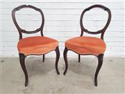 Sale 9068 - Lot 1088 - Set of Four Victorian Carved Rosewood Balloon Back Chairs, with burnt orange velvet seats & cabriole legs (H:85.5 x W:45.5 x D:50cm)