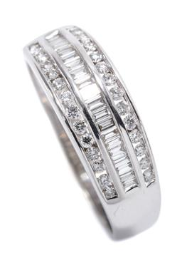Sale 9199J - Lot 55 - A 9CT WHITE GOLD QUARTER HOOP DIAMOND RING; central band channel set with 20 baguette cut diamonds totalling 0.20ct flanked by 2 rows..