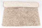 Sale 8770 - Lot 100 - A contemporary shag-pile mushroom coloured woollen rug, W x 200cm, L x 300cm