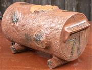 Sale 8984W - Lot 585 - An Australiana themed terracotta letterbox in the form of a hollowed log. Length 39cm