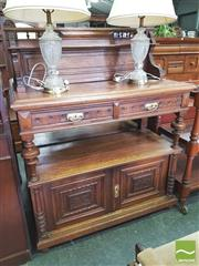 Sale 8428 - Lot 1088 - Early 20th French Oak Dumbwaiter, with small shelf to back, above two drawers, another open shelf & two carved panel doors