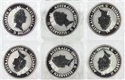 Sale 8679 - Lot 374 - SIX AUSTRALIAN 1991 KOOKABURRA 1 OUNCE SPECIMEN SILVER COINS; .999 fine silver encased in perspex.