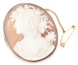 Sale 9160 - Lot 359 - AN ANTIQUE 9CT ROSE GOLD FRAMED CAMEO BROOCH; oval finely carved shell cameo depicting portrait of Bacchante in a plain frame with 1...