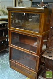 Sale 8460 - Lot 1054 - Early 20th Century Possibly French Walnut Stacking Bookcase, with three glass panel doors & a drawer