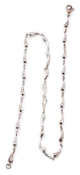 Sale 9169 - Lot 357 - A SILVER TEARDROP NECKLACE; Tiffany copy of teardrop links in nickel silver to lobster claw clasp, length 41cm, wt. 20.88g.