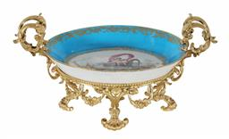 Sale 9245J - Lot 73 - A French 18th century Sevres comport, with hand painted decoration of the cupid riding the mythical sea fish, mounted in fine ormolu...