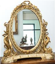 Sale 8338A - Lot 28 - A Louis XVI style carved and gilt gesso toilet mirror, with dolphin supports, H 93cm