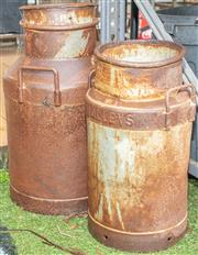 Sale 8984W - Lot 589 - A pair of milk cans, the taller with lid. Measures 60cm