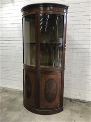 Sale 9068 - Lot 1003 - Sheraton Style Mahogany Corner Display Cabinet, with two bent glass panel doors, the lower doors with oval flame panels on satinwood...