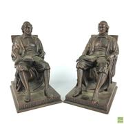 Sale 8589R - Lot 7 - Bronze Figural Bookends depicting John Harvard (H: 19cm)