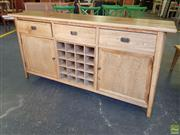 Sale 8601 - Lot 1306 - Oak Retro Style Sideboard with Three Drawers, Two Doors & Central Wine Rack (H: 91 W: 180 D: 44cm)