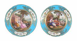 Sale 9245J - Lot 75 - A pair of French 18th century Sevres cabinet plates, with hand painted central panels depicting the romantic couples and ladies in l...