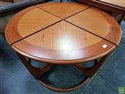 Sale 8930 - Lot 1071 - Circular G-Plan Teak Coffee Table with Four Tables Underneath