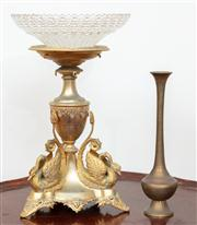 Sale 8804A - Lot 132 - A Victorian gilt metal swan base with associated dish and small brass vase, tallest 30cm