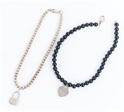 Sale 9120K - Lot 29 - Two Tiffany & Co. beaded heart and padlock bracelets