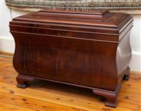 Sale 8735 - Lot 1 - A Georgian style mahogany wine cooler, the sarcophagus body on bracket feet, H 53cm x W 70cm x D 44cm