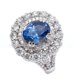 Sale 9199J - Lot 58 - AN 18CT WHITE GOLD SAPPHIRE AND DIAMOND DRESS RING; centring a 1.99ct oval cut fine blue sapphire  to  double surround of 43 round b...