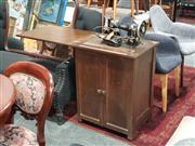 Sale 8863 - Lot 1029 - Vintage Sewing Machine in Oak Cabinet