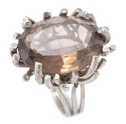 Sale 9169 - Lot 330 - A VINTAGE SILVER QUARTZ COCKTAIL RING; modernist setting with an oval cut quartz of approx. 11.50ct, width 25mm, size N 1/2, wt. 10.8g.