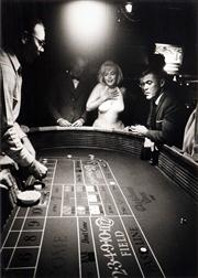 Sale 8592A - Lot 5018 - Eve Arnold (1912 - 2012) - Marilyn Monroe and Mistfit crew at Christmas Tree Inn & Casino in Nevada 43 x 30.5cm (mount size: 72 x 54...