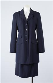 Sale 8685F - Lot 16 - A Gianni navy blue wool-blend womens suit, to include a kent blazer, trousers and a skirt (all US 4)