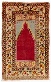 Sale 8770 - Lot 54 - An antique Turkish prayer rug with Madder red mihrab, 187cm x 117cm