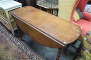 Sale 8345 - Lot 1084 - 19th Century Mahogany Drop-Leaf Table, forming an oval top on turned legs