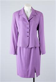 Sale 8685F - Lot 64 - A Gianni womens suit in mauve wool, to include a fitted jacket  (US 6) and an A-line skirt (US 4)