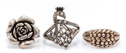 Sale 9169 - Lot 388 - THREE SILVER RINGS; 9ct gold lined silver keeper ring, size size R, width 10.3mm, and silver rose and peacock rings sizes L & Q1/2,...
