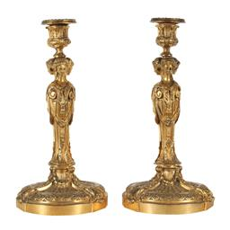 Sale 9245J - Lot 79 - A pair of French 19th century candle sticks with figural decoration, H 30cm x W 14cm.