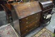 Sale 8359 - Lot 1086 - George III Provincial Oak Bureau with 4 long graduated drawers on bracket feet.