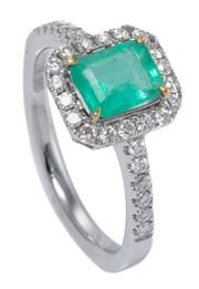 Sale 9015J - Lot 68 - AN EMERALD AND DIAMOND RING; set in 14ct white gold with a 0.83ct emerald cut emerald to surround and shoulders set with 30 round br...