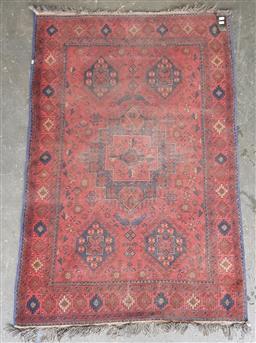Sale 9121 - Lot 1078 - Afghan wool central medallion red & blue tone carpet (155 x 100cm)