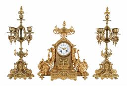Sale 9245J - Lot 60 - A French 19th century three piece ormolu salon clock set, with central clock with phoenix and urn decoration with side candelabra an...