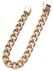 Sale 9054 - Lot 385 - A 9CT GOLD CURB BRACELET; 9.3mm wide links to a box clasp with safety clip, length 19cm, wt. 28.59g.