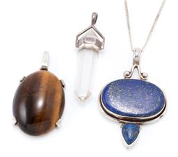 Sale 9169 - Lot 365 - THREE SILVER STONE SET PENDANTS; oval cabochon tigers eye, size 41 x 22mm, rock crystal size 42 x 12mm, and other oval plaque and p...