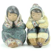 Sale 8314 - Lot 82 - Lladro Figures Pensive Eskimo Boy & Pensive Eskimo Girl by Francisco Catalá