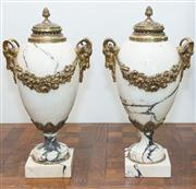 Sale 8338A - Lot 33 - A pair of Louis XVI style egg shaped white marble urns, with covers and goat masks, H 46cm