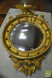 Sale 8335 - Lot 1026 - Georgian Style Gilt Convex Mirror, surmounted by an eagle with cannon shot
