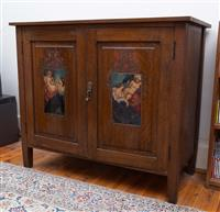 Sale 8735 - Lot 4 - An important oak art deco cabinet with two painted door panels by Norman Lindsay circa 1925. Each panel painted with Nudes of Sirens...