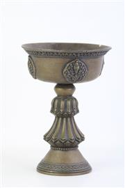 Sale 8802 - Lot 123 - Large Tibetan Bronze Butter Lamp, raised on tall lotus-petal shaped stem, with bowl decorated with Buddhist symbols, Dia; 14cm, H; 20cm