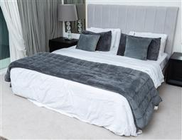 Sale 9150H - Lot 77 - A king sized bed with grey upholstered bedhead, height of bedhead 129cm, with bedding
