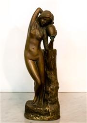 Sale 8516A - Lot 54 - A bronze figure of a bathing maiden. 31cm high