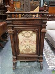 Sale 8634 - Lot 1024 - Late 19th/ Early 20th Century French Carved Walnut Firescreen, with arcaded top, flanked by scaly square supports & floral fabric panel