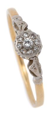 Sale 9046 - Lot 398 - A VINTAGE 18CT GOLD DIAMOND CLUSTER RING; illusion set with a round brilliant cut diamond surrounded by 8 single cut diamonds, size...