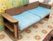 Sale 9066H - Lot 194 - A vintage art deco daybed with integral bookshelf, converts to a bed. H 68cm W 210cm D 75cm. With blue upholstered cushion.