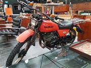 Sale 8476 - Lot 1045 - A 1970s Suzuki 100cc 2 stroke motorbike. 5,403km, kickstart, driving lights, blinkers, hand guards, luggage rack, good rubber, orig...